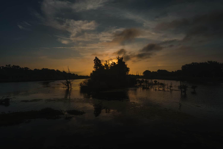 zonsondergang biesbosch nederland